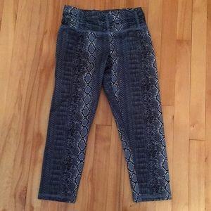 Blue leggings. Snake skin motif.